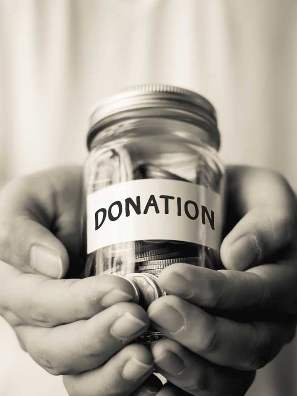 Donation Jar in Hands