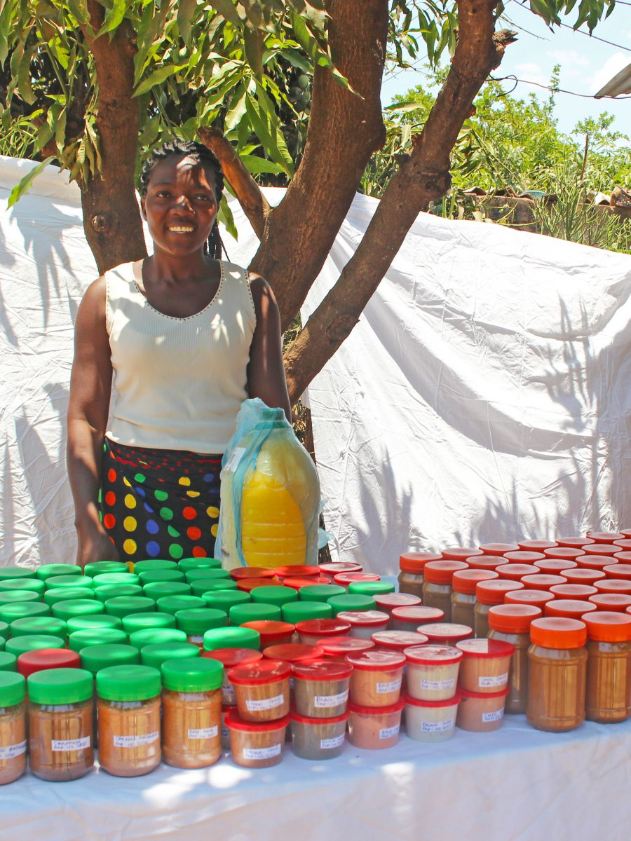 Village banking women selling peanut butter